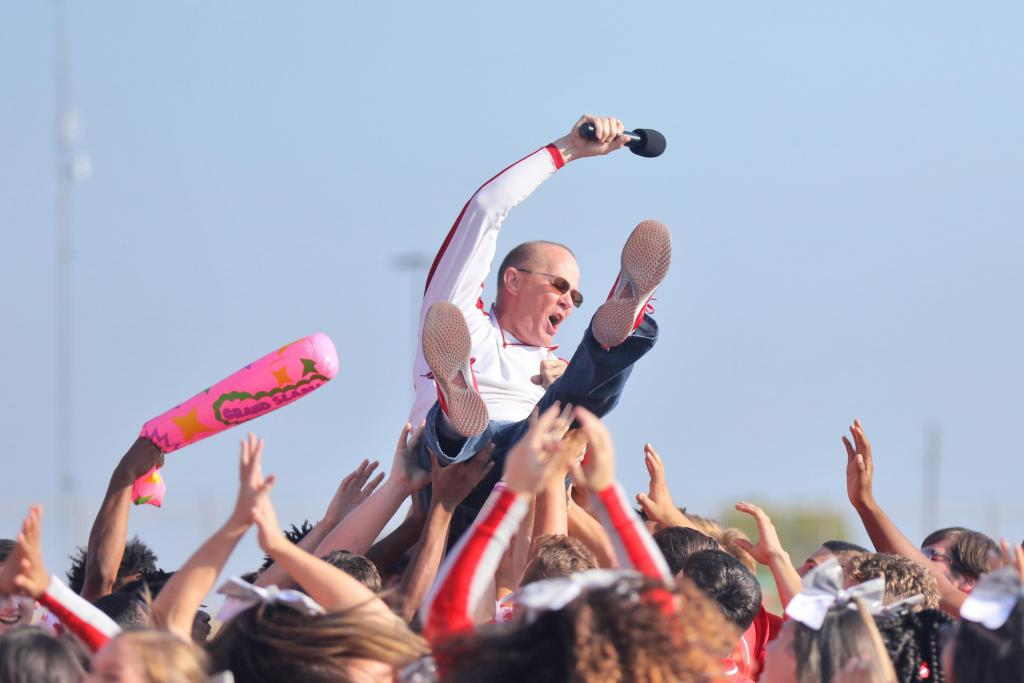 Coach Sloan hyped up all the students at the campus-wide Homecoming Pep-Rally, calling on each school individually to shout out their battle cries before jumping backward into a sea of GHS Varsity Football players who caught him crowd-surf style. Angela Crane photo