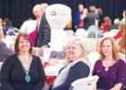 Tables adorned with thematic decorations filled the Groesbeck Convention Center for its annual banquet. Pictured is Kerrie Cobb, Karmen Hoffpauir and Stacie Hall with a homemade Groesbeck water tower in the background. Table themes ranged from around the