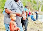 (LEFT) Elvis Ford, of Thornton, helps his grandson Axel Ford, 5, also of Thornton, bait his rod and reel at the Annual Youth Fishing Clinic, at Fort Parker State Park. This fishing session took place Saturday afternoon; other sessions were held Saturday m