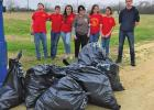 Young Marines clean up area, looking for service hours