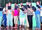Former music students of Mexia songwriter Cindy Walker sing two numbers at the Cindy Walker Tribute Concert they learned as children while doing musicals Walker directed. Shown here, l-r, are Romelda Moffett, Troy Miller, Laurie Chaney, Dick Flatt, Kathy (Hitt) Rogers, Frank Parker, Sharon (Yelverton) Garber, Alden Garber, Sissie (Garber) Ingram, Ginger Pickett and Andrea Ingram.