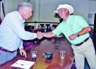 Opponents in the May 22 Republican runoff for Limestone County Judge: Richard Duncan, left, and Mark Roark shake hands immediately after the results were announced that Duncan was the winner. The two and their supporters spent the evening in the county courtroom and judge's chambers of the courthouse.  Photo by Roxanne Thompson/Groesbeck Journal